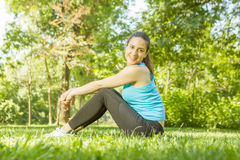 Happy fitness girl relaxing Stock Image