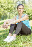 Happy fitness girl relaxing Stock Photos