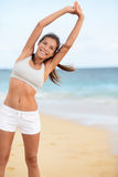 Happy fitness girl stretching for run workout royalty free stock photography