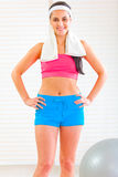 Happy fitness girl with towel around neck Stock Images