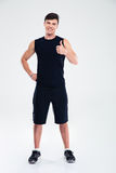 Happy fitness man showing thumb up Royalty Free Stock Photo