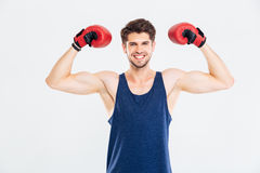Happy fitness man standing with red boxing gloves Royalty Free Stock Photography