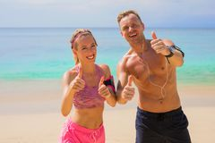 Happy fitness people on the beach. Enjoying success after workout stock photography