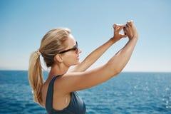 Happy fitness selfie woman smiling taking self portrait Stock Image