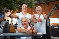 Happy fitness team in gym Stock Photos