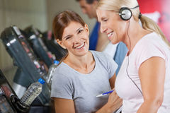 Happy fitness trainer coaching. Senior women in gym Royalty Free Stock Images