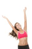 Happy fitness woman with arms raised looking up. Fitness woman. Smiling happy asian fitness girl with arms raised looking up. Gorgeous smiling mixed race chinese royalty free stock photography