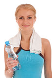 Happy fitness woman with bottle of water and towel Royalty Free Stock Images