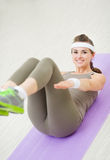 Happy fitness woman doing gymnastics exercises Stock Photography