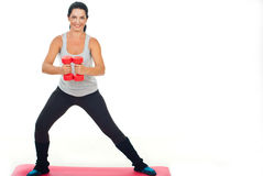 Happy fitness woman with dumb bell Stock Image