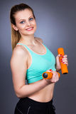 Happy fitness woman  with dumbbells working out Stock Image