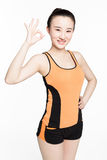 Happy fitness woman gesturing Stock Image