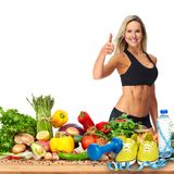 Happy fitness woman. Happy young woman and vegetables on the table isolated white background stock photo