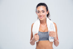 Happy fitness woman holding bottle with water Stock Photo