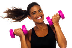 Happy fitness woman lifting dumbbells Stock Images