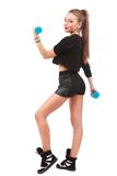 Happy fitness woman lifting dumbbells smiling cheerful, fresh an Stock Photos