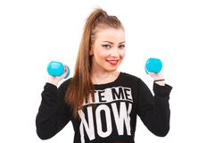 Happy fitness woman lifting dumbbells smiling cheerful, fresh an Royalty Free Stock Photography