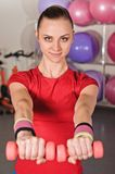 Happy fitness woman lifting dumbbells Royalty Free Stock Image