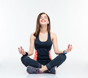 Happy fitness woman meditating Stock Image
