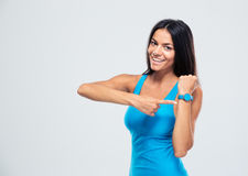 Happy fitness woman pointing on fitness tracker Stock Photography