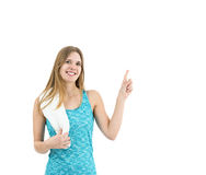 Happy fitness woman pointing to copy space Stock Photo