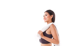 Happy fitness woman posing with towel Stock Photos