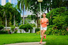 Happy fitness woman running at city park Royalty Free Stock Photos
