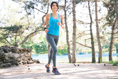 Happy fitness woman running outdoors Stock Images