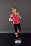 Happy fitness woman s on scale Royalty Free Stock Image