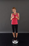 Happy fitness woman in scale isolated Stock Photo