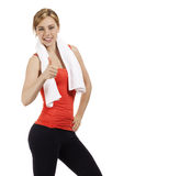 Happy fitness woman showing thumb up Royalty Free Stock Photography