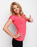 happy fitness woman showing thumb up Royalty Free Stock Photo