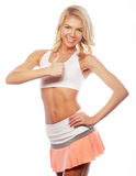 happy fitness woman showing thumb up Stock Photography