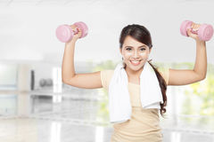 Happy fitness woman workout with dumbbells Royalty Free Stock Images