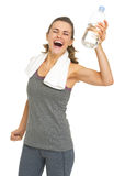 Happy fitness young woman with bottle of water rejoicing Stock Images