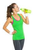 Happy fitness young woman drinking water Royalty Free Stock Photo