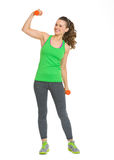 Happy fitness young woman with dumbbells showing biceps Stock Photo