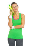 Happy fitness young woman enjoying cold bottle of water Stock Photo