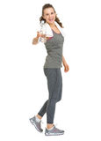 Happy fitness young woman giving bottle of water Stock Photography