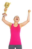 Happy fitness young woman with gold trophy cup rejoicing Stock Images