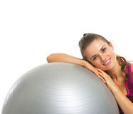 Happy fitness young woman laying on fitness ball Stock Photos