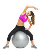 Happy fitness young woman making exercise on fitness ball Stock Photography