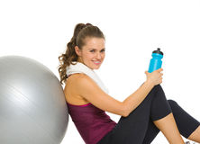 Happy fitness young woman relaxing after workout Royalty Free Stock Photography