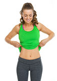 Happy fitness young woman showing belly Stock Image