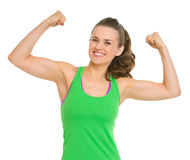Happy fitness young woman showing biceps Stock Images