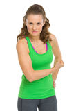 Happy fitness young woman showing biceps Stock Image