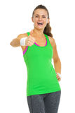 Happy fitness young woman showing thumbs up Stock Photography