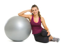 Happy fitness young woman sitting near fitness ball Stock Photo
