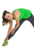 Happy fitness young woman stretching Royalty Free Stock Photos
