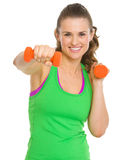 Happy fitness young woman workout with dumbbells Stock Photo